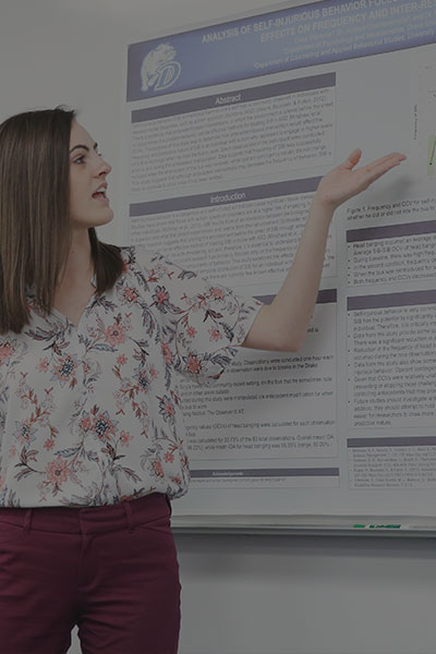 Female student presenting at white board