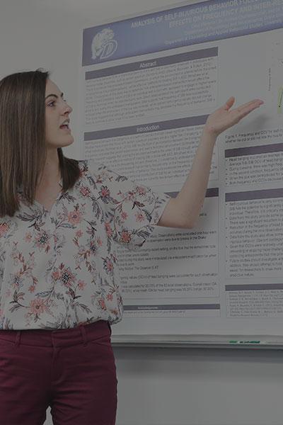 Female student presenting at white board